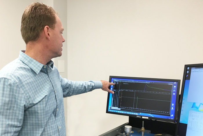 ORS employee showing test results on a monitor